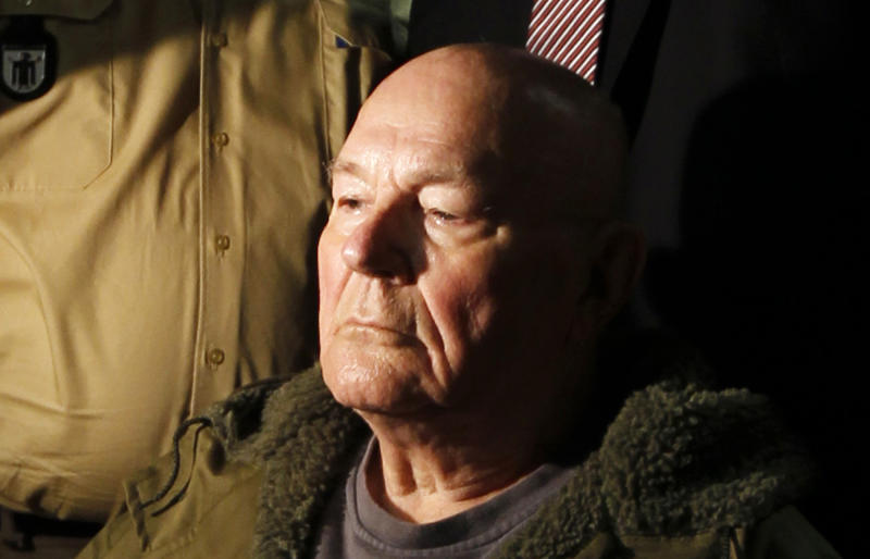 FILE - In this May 12. 2011 file picture John Demjanjuk waits in a courtroom in Munich. German police say John Demjanjuk, who  was  charged with 28,060 counts of accessory to murder  and convicted last year of serving as a Nazi death camp guard, has died.  Rosenheim police official Kilian Steger told The Associated Press the 91-year-old died Saturday  March 17, 2012 at the home for elderly people in southern Germany where he stayed since the end of his trial in Munich last year. Demjanjuk, a retired Ohio autoworker, was deported to Germany in 2009 to face trial after being stripped of his U.S. citizenship. (AP Photo/Matthias Schrader, File)