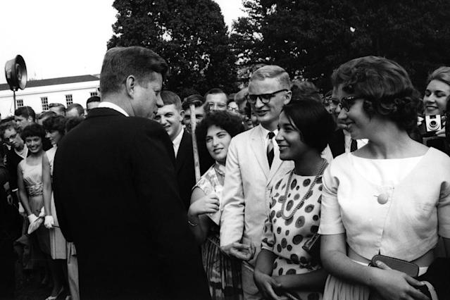 <p>President John F. Kennedy greets Peace Corps volunteers on the South Lawn of the White House in Washington, Aug. 9, 1962. (Photo: Rowland Scherman/Peace Corps/John F. Kennedy Presidential Library and Museum) </p>
