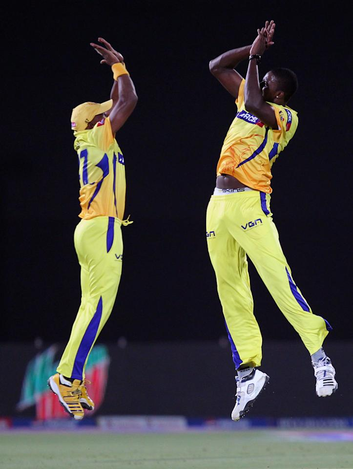 Dwayne Bravo and Jason Holder celebrates wicket of James Faulkner during match 61 of the Pepsi Indian Premier League ( IPL) 2013  between The Rajasthan Royals and the Chennai Super Kings held at the Sawai Mansingh Stadium in Jaipur on the 12th May 2013 (BCCI)