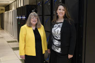 In this July 19, 2021, photo Amanda Crawford, right, and Nancy Rainosek, left, pose for a photo inside the state's Information Resources Data Center in Austin, Texas. (AP Photo/Chuck Burton)