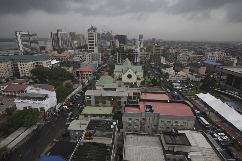 In this photo taken Sunday, March. 25, 2012, An aerial view of Lagos island were most of historical buildings are located in Lagos, Nigeria. What is predicted to become the most populous city in Africa was initially ignored by the Portuguese explorers who first dominated it, served as a hub for a brutal slave trade and once held the hope of a continent that even now struggles to overcome its colonial past.(AP Photos/Sunday Alamba)