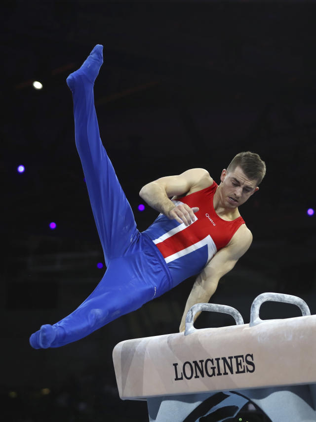Gold medalist Max Whitlock of Great Britain performs on the pommel horse in the men's apparatus finals at the Gymnastics World Championships in Stuttgart, Germany, Saturday, Oct. 12, 2019. (AP Photo/Matthias Schrader)