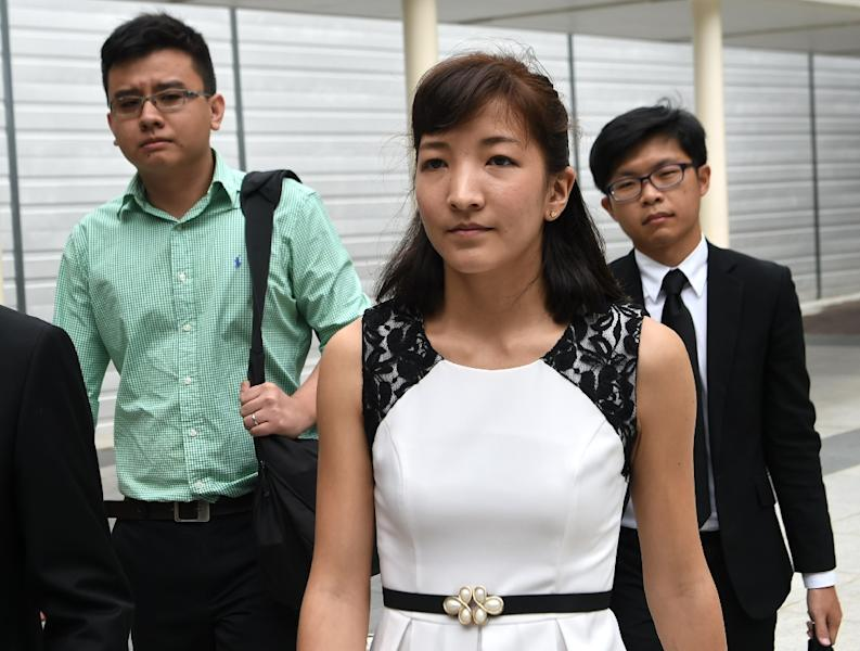 "Australian Japanese Ai Takagi (front) and her Singaporean husband Yang Kaiheng (left), each face 7 sedition charges for articles published between October 2013 and February 2015 on the socio-political website ""The Real Singapore"" (AFP Photo/Roslan Rahman)"