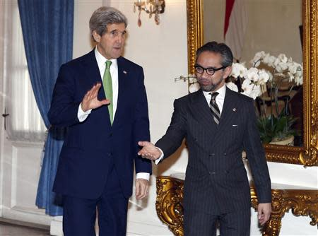 U.S. Secretary of State John Kerry shakes hands with Indonesia's Foreign Minister Marty Natalegawa at the Foreign Ministry office before a meeting in Jakarta