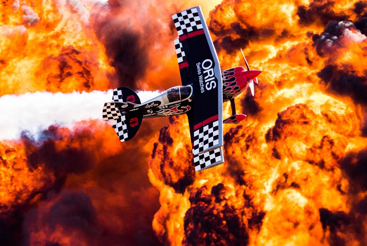 <p>A wall of fire explodes behind a plane during an aerobatic and pyrotechnics display at the Australian International Airshow. (Rex) </p>
