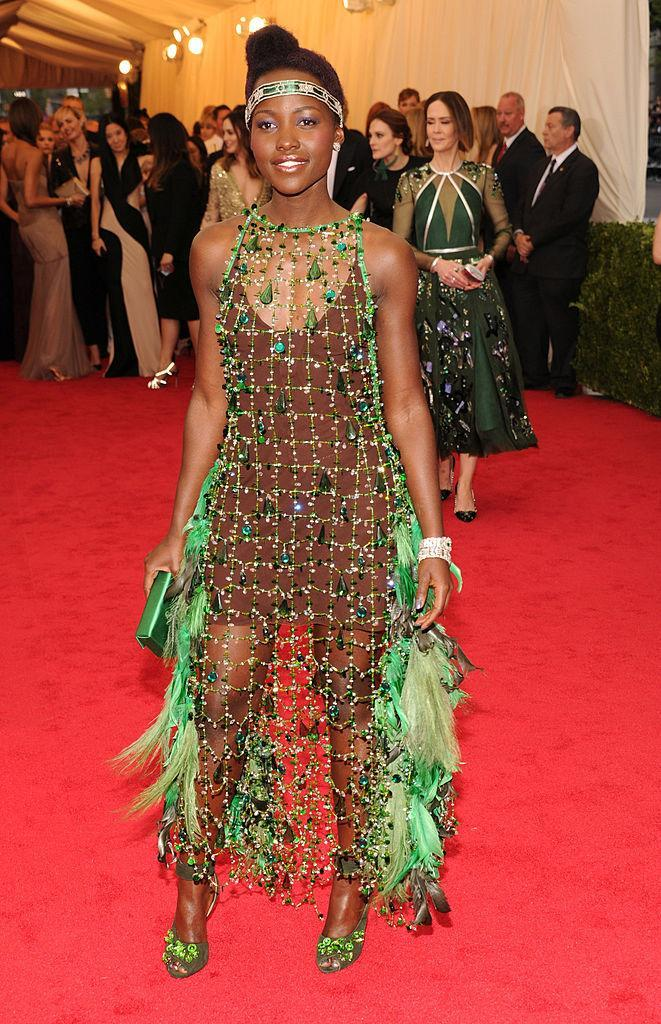 <p>Lupita — you set your own sky-high fashion standards. Now you have to live by them. <i>(Photo via Getty Images)</i> </p>