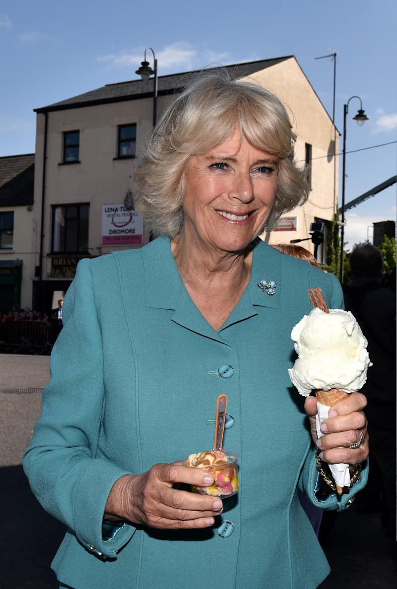 Camilla Parker Bowles double-fisting ice cream during a visit to the village market in Droromore, Northern Ireland, May 2017.