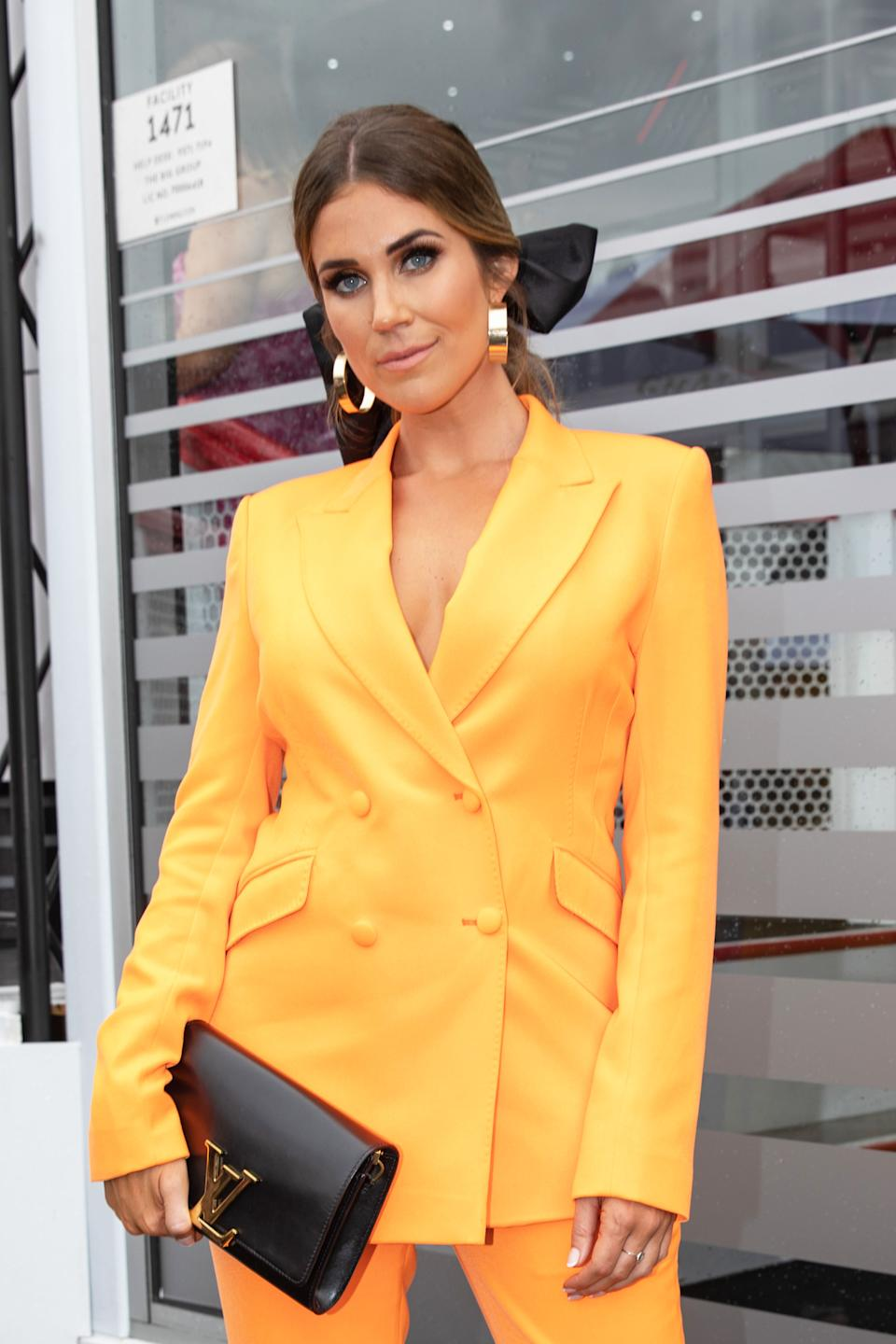 Georgia Love (pictured at Melbourne Cup in yellow suit) says Bachelor in Paradise's Ciarran Stott Tim Hanley 'horribly unattractive'