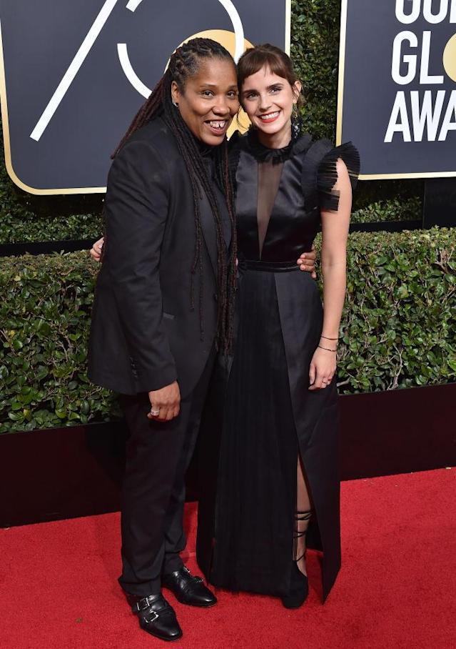 Activist Marai Larasi, left, and Emma Watson attend the Golden Globe Awards. (Photo: Axelle/Bauer-Griffin/FilmMagic)