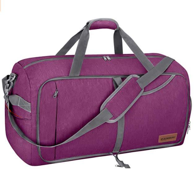 "Find this Canway 65L Travel Duffel Bag for $27 on <a href=""https://amzn.to/2Cug9eg"" rel=""nofollow noopener"" target=""_blank"" data-ylk=""slk:Amazon"" class=""link rapid-noclick-resp"">Amazon</a>."