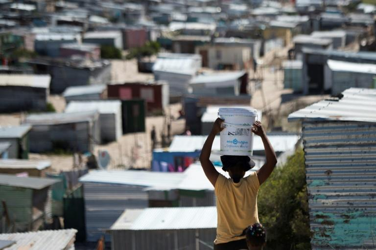 Coronavirus is starting to spread in South Safrica, but in Khayelitsha, a slum near Cape Town, even basic sanitation and running water are a dream (AFP Photo/RODGER BOSCH)