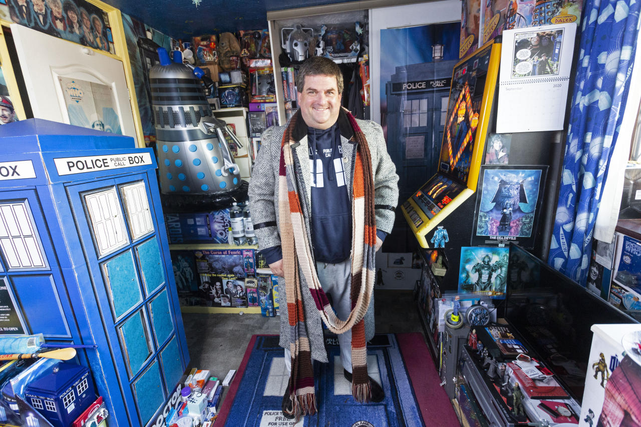 """A Doctor Who superfan has laid claim to having the world's largest collection of the show's memorabilia - after spending over £100,000 on """"at least a million"""" items. Brian Mattocks, 50, says he became """"obsessed"""" with the hit BBC series after watching an episode in 1979 which ended on a cliffhanger - and he hasn't missed an episode since. His loving parents bought the then nine-year-old boy a Dalek action figure which kickstarted his lifelong passion for collecting items from the show. Daleks are a fictional extraterrestrial race of mutants which are found in the series which has been running on BBC One since 1963. A Welsh schoolgirl, Lily Connors, recently bagged a Guinness World Record after amassing 6,641 Doctor Who items. Devoted Brian believes his """"shrine"""" could easily beat but it would """"take months to count""""."""