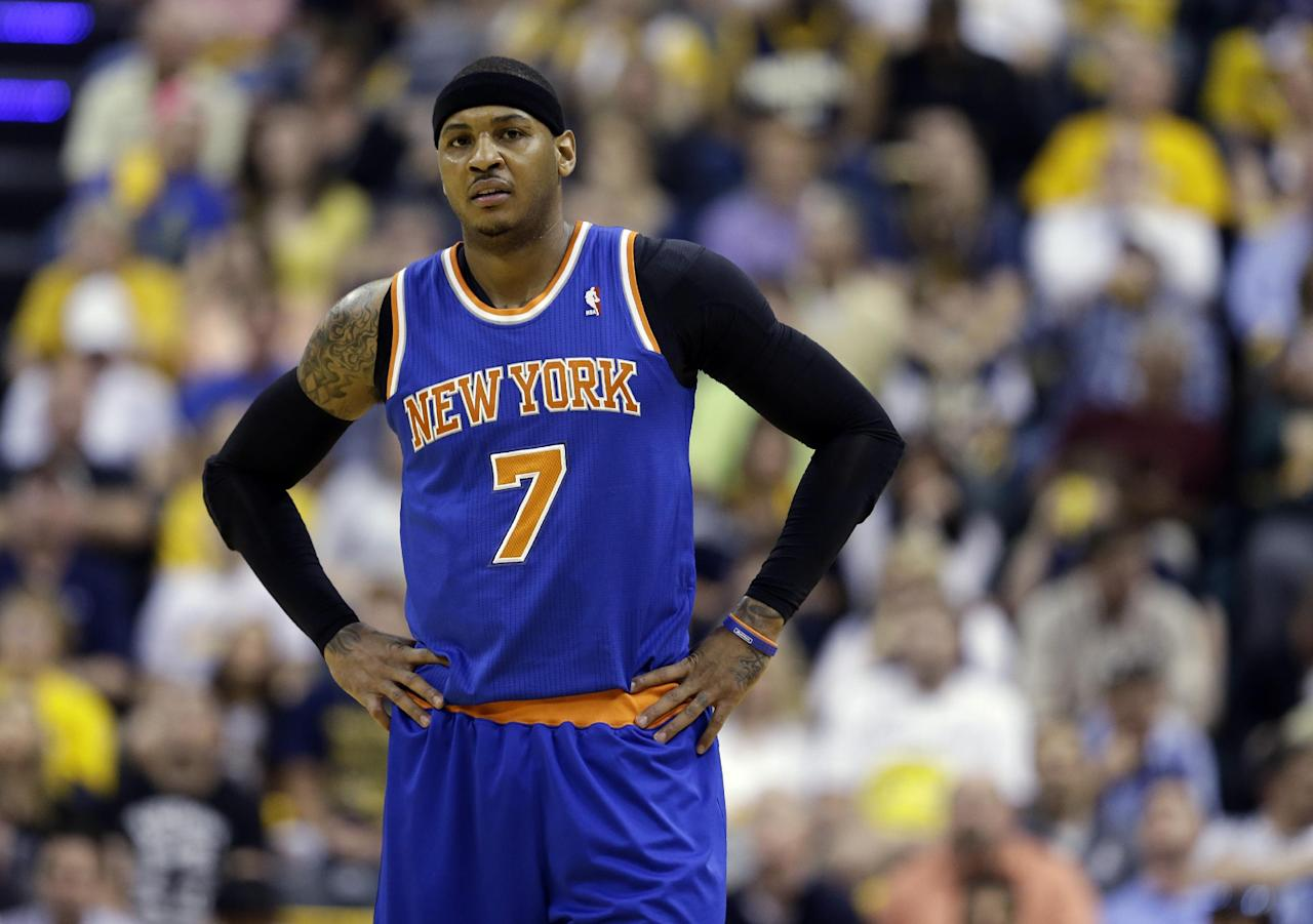 New York Knicks' Carmelo Anthony pauses during the first half of Game 4 of an Eastern Conference semifinal NBA basketball playoff series against the Indiana Pacers on Tuesday, May 14, 2013, in Indianapolis. (AP Photo/Darron Cummings)