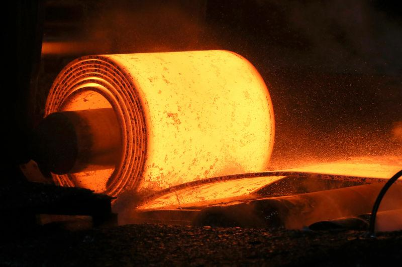 FILE PHOTO: A steel coil is unrolled on the line at a steel mill in Pennsylvania