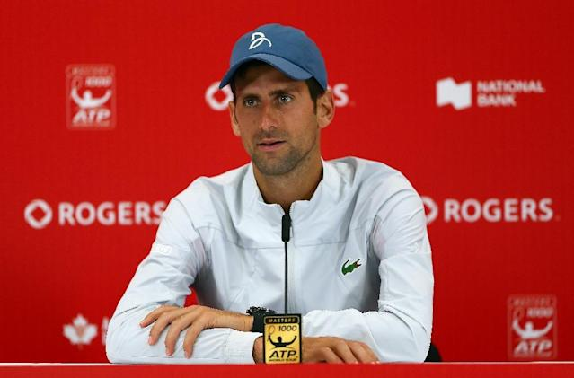 Serbia's Novak Djokovic, shown here speaking to reporters after defeating Canada's Peter Polansky in the 2nd round at the Rogers Cup in Toronto -- back Davis Cup reform (AFP Photo/Vaughn Ridley)