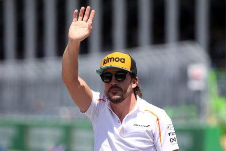 FILE PHOTO: Formula One F1 - Canadian Grand Prix - Circuit Gilles Villeneuve, Montreal, Canada - June 10, 2018 McLaren's Fernando Alonso before the race REUTERS/Carlo Allegri