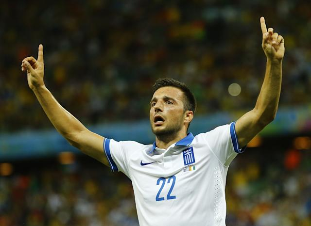Greece's Samaris celebrates after scoring a goal against Ivory Coast during their 2014 World Cup Group C soccer match at the Castelao arena in Fortaleza