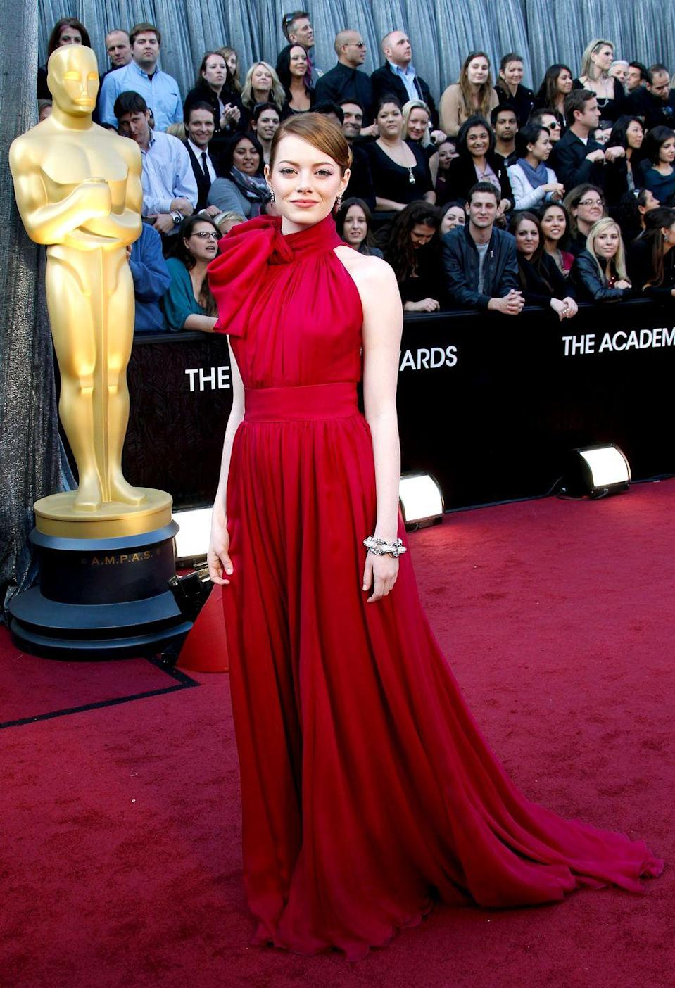 <p>This fuchsia Giambattista Valli gown featuring a cinched waist and dramatic pussybow was such a stunner in 2012. She presented the award for Best Visual Effects with Ben Stiller later on stage. </p>