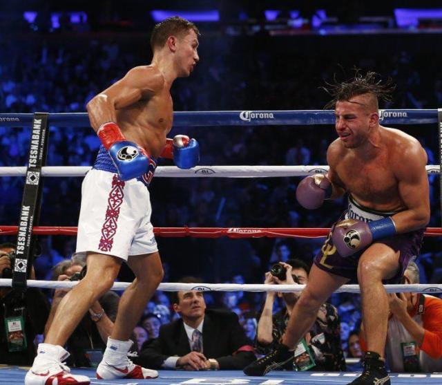 Gennady Golovkin (L) moves in for the finish on David Lemieux in their 2015 middleweight title fight in New York. (Getty Images)
