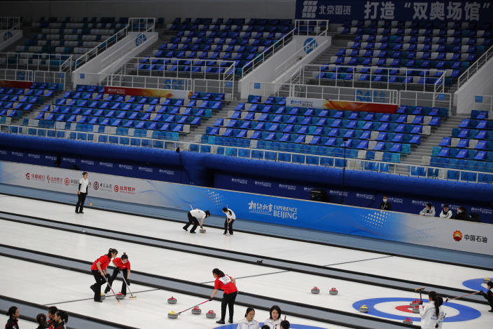 """Local teams compete in a curling competition during a test event for the 2022 Beijing Winter Olympics at the National Aquatic Center, also known as the """"Water Cube"""" in Beijing, Saturday, April 3, 2021. The organizers of the 2022 Beijing Winter Olympics has started 10 days of testing for several sport events in five different indoor venues from April 1-10, becoming the first city to hold both the Winter and Summer Olympics. (AP Photo/Andy Wong)"""