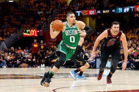 May 19, 2018; Cleveland, OH, USA; Boston Celtics forward Jayson Tatum (0) drives to the basket in front of Cleveland Cavaliers forward Larry Nance Jr. (22) during the second half in game three of the Eastern conference finals of the 2018 NBA Playoffs at Quicken Loans Arena. Mandatory Credit: Rick Osentoski-USA TODAY Sports