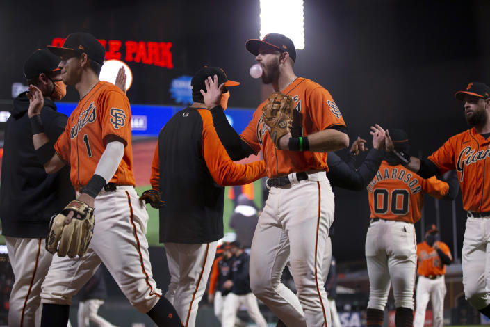 San Francisco Giants celebrate a 5-4 victory over the San Diego Padres in a baseball game Friday, May 7, 2021, in San Francisco. (AP Photo/D. Ross Cameron)