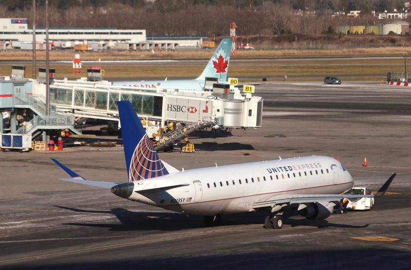 FILE PHOTO: A United Express Embraer ERJ-175LR airplane is pictured at Vancouver's international airport in Richmond,