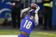 Buffalo wide receiver Trevor Wilson catches a pass for a touchdown during the first half of the Mid-American Conference championship NCAA college football game against Ball State, Friday, Dec. 18, 2020, in Detroit. (AP Photo/Carlos Osorio)