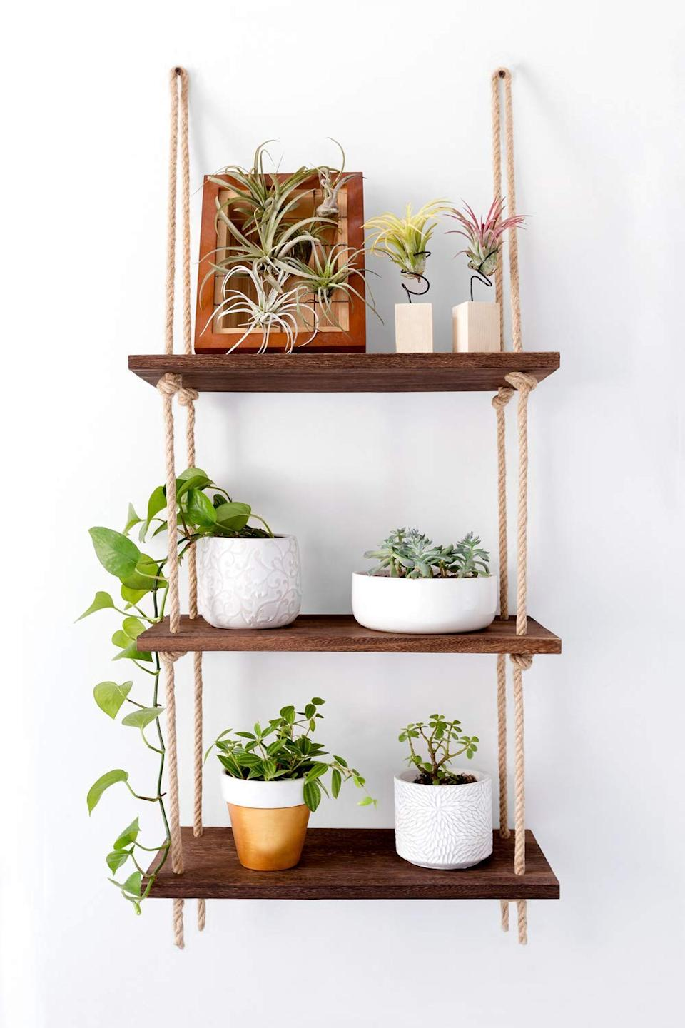 """<h3><a href=""""https://www.amazon.com/Mkono-Hanging-Storage-Shelves-Organizer/dp/B07DLMP23H/ref=sr_1_16"""" rel=""""nofollow noopener"""" target=""""_blank"""" data-ylk=""""slk:Wood Hanging Wall Shelf"""" class=""""link rapid-noclick-resp"""">Wood Hanging Wall Shelf</a></h3><br>This bohemian storage solution has multipurpose shelving power for any area inside your space — whether it's streamlining kitchen essentials to books or beauty goods.<br><br><strong>Mkono</strong> Wood Hanging Shelf Wall, $, available at <a href=""""https://www.amazon.com/Mkono-Hanging-Storage-Shelves-Organizer/dp/B07DLMP23H/ref=sr_1_16"""" rel=""""nofollow noopener"""" target=""""_blank"""" data-ylk=""""slk:Amazon"""" class=""""link rapid-noclick-resp"""">Amazon</a>"""