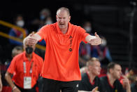 Germany head coach Henrik Rodl reacts during men's basketball preliminary round game against Italy at the 2020 Summer Olympics, Sunday, July 25, 2021, in Saitama, Japan. (AP Photo/Charlie Neibergall)