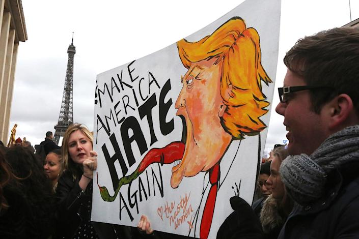 <p>Protesters hold a sign during a demonstration against U.S. President Donald Trump on the Trocadero in Paris, Feb. 4, 2017. (Photo: Owen Franken/Corbis via Getty Images) </p>