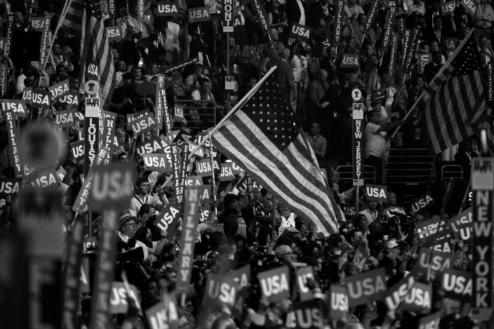<p>Delegates wave flags during the DNC in Philadelphia, PA. on Jauly 28, 2016. (Photo: Khue Bui for Yahoo News)</p>