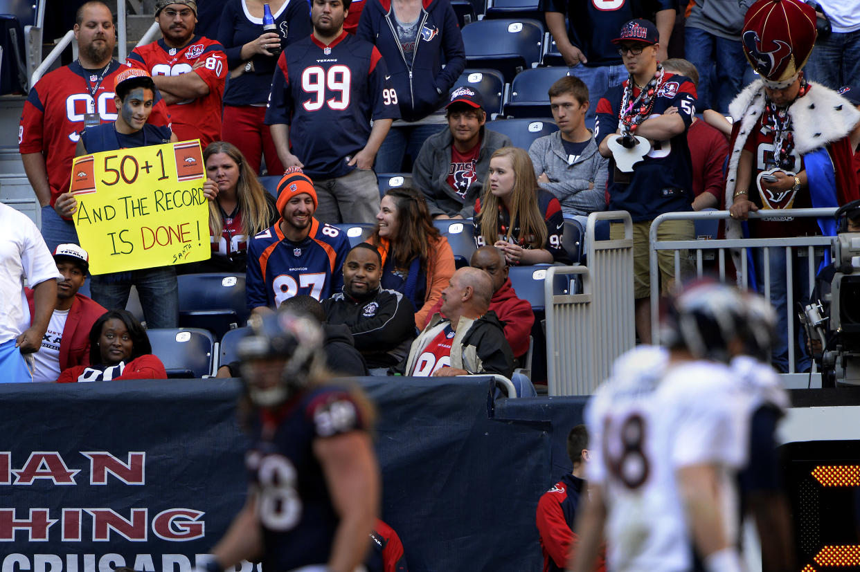 HOUSTON, TX. - December 22: Fan waiting for quarterback Peyton Manning #18 of the Denver Broncos to break the record against the Houston Texans at Reliant Stadium December 22, 2013 Houston, Texas. (Photo By Joe Amon/The Denver Post via Getty Images)