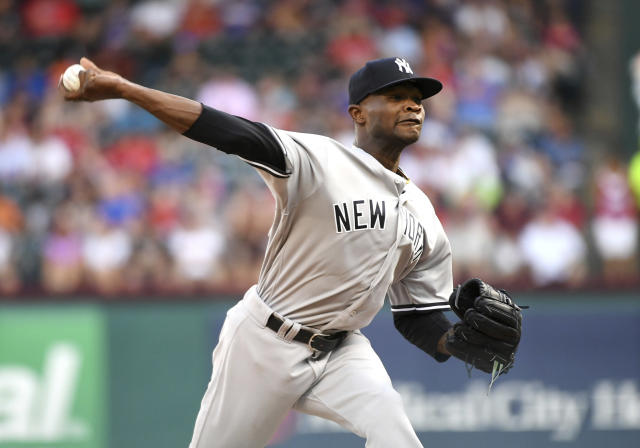 New York Yankees starting pitcher Domingo German works against the Texas Rangers during the first inning of a baseball game Tuesday, May 22, 2018, in Arlington, Texas. (AP Photo/Jeffrey McWhorter)