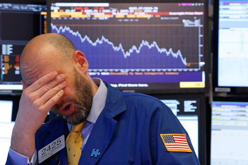 A trader reacts near the end of the day on the floor of the New York Stock Exchange: REUTERS/Brendan Mcdermid