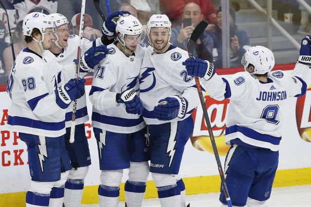 Tampa Bay Lightning's Mikhail Sergachev (98), Ondrej Palat (18), Anthony Cirelli (71), Kevin Shattenkirk (22) and Tyler Johnson (9) celebrate Cirelli's hat-trick goal against the Winnipeg Jets during third-period NHL hockey game action in Winnipeg, Manitoba, Friday, Jan. 17, 2020. (John Woods/The Canadian Press via AP)