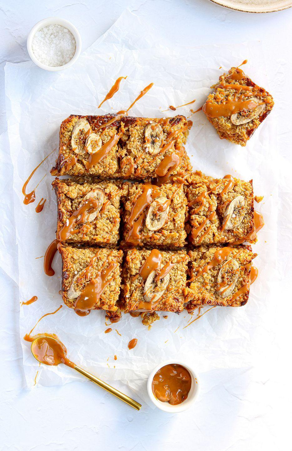 """<p>Banana <a href=""""https://www.delish.com/uk/cooking/recipes/a35486970/vegan-flapjacks/"""" rel=""""nofollow noopener"""" target=""""_blank"""" data-ylk=""""slk:flapjacks"""" class=""""link rapid-noclick-resp"""">flapjacks </a>are seriously tasty, especially when paired with <a href=""""https://www.delish.com/uk/cooking/recipes/g28842354/salted-caramel-desserts/"""" rel=""""nofollow noopener"""" target=""""_blank"""" data-ylk=""""slk:salted caramel"""" class=""""link rapid-noclick-resp"""">salted caramel</a>. We've added mashed <a href=""""https://www.delish.com/uk/cooking/recipes/g28843835/banana-bread-recipes/"""" rel=""""nofollow noopener"""" target=""""_blank"""" data-ylk=""""slk:bananas"""" class=""""link rapid-noclick-resp"""">bananas </a>to the oat mixture and sprinkled on top for added banana goodness. </p><p>Get the <a href=""""https://www.delish.com/uk/cooking/recipes/a35487496/banana-flapjack/"""" rel=""""nofollow noopener"""" target=""""_blank"""" data-ylk=""""slk:Caramelised Banana Flapjack"""" class=""""link rapid-noclick-resp"""">Caramelised Banana Flapjack</a> recipe</p>"""