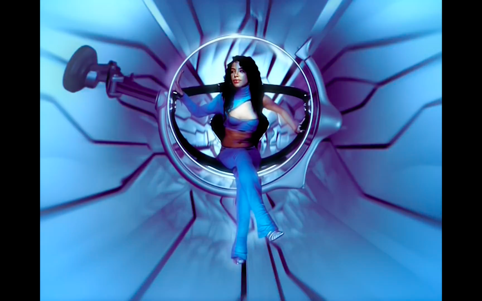 """<cite class=""""credit"""">Screenshot/Youtube. """"We Need A Resolution"""" music video, Aaliyah. </cite>"""