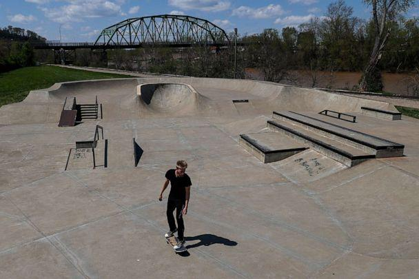 PHOTO: A skateboarder skates at Fort Neal Park on April 15, 2020 in Parkersburg, W.Va. (Patrick Smith/Getty Images)