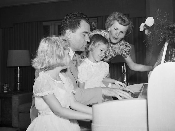 Richard Nixon with his wife and daughters.