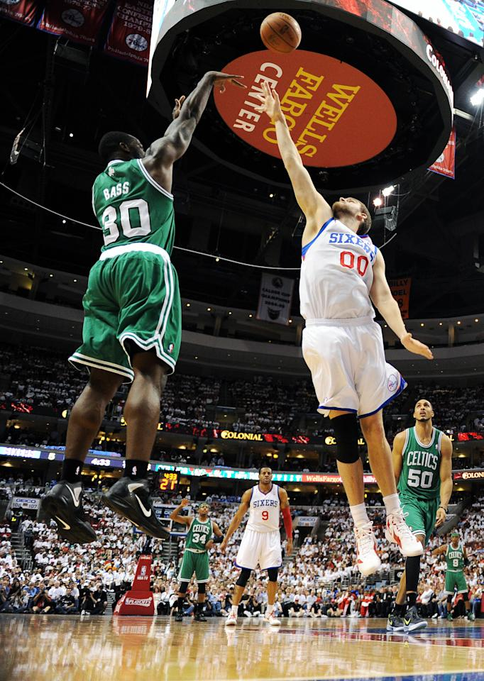 PHILADELPHIA, PA - MAY 18: Brandon Bass #30 of the Boston Celtics shoots over Spencer Hawes #00 of the Philadelphia 76ers in Game Four of the Eastern Conference Semifinals in the 2012 NBA Playoffs at the Wells Fargo Center on May 18, 2012 in Philadelphia, Pennsylvania. NOTE TO USER: User expressly acknowledges and agrees that, by downloading and or using this photograph, User is consenting to the terms and conditions of the Getty Images License Agreement. (Photo by Drew Hallowell/Getty Images)
