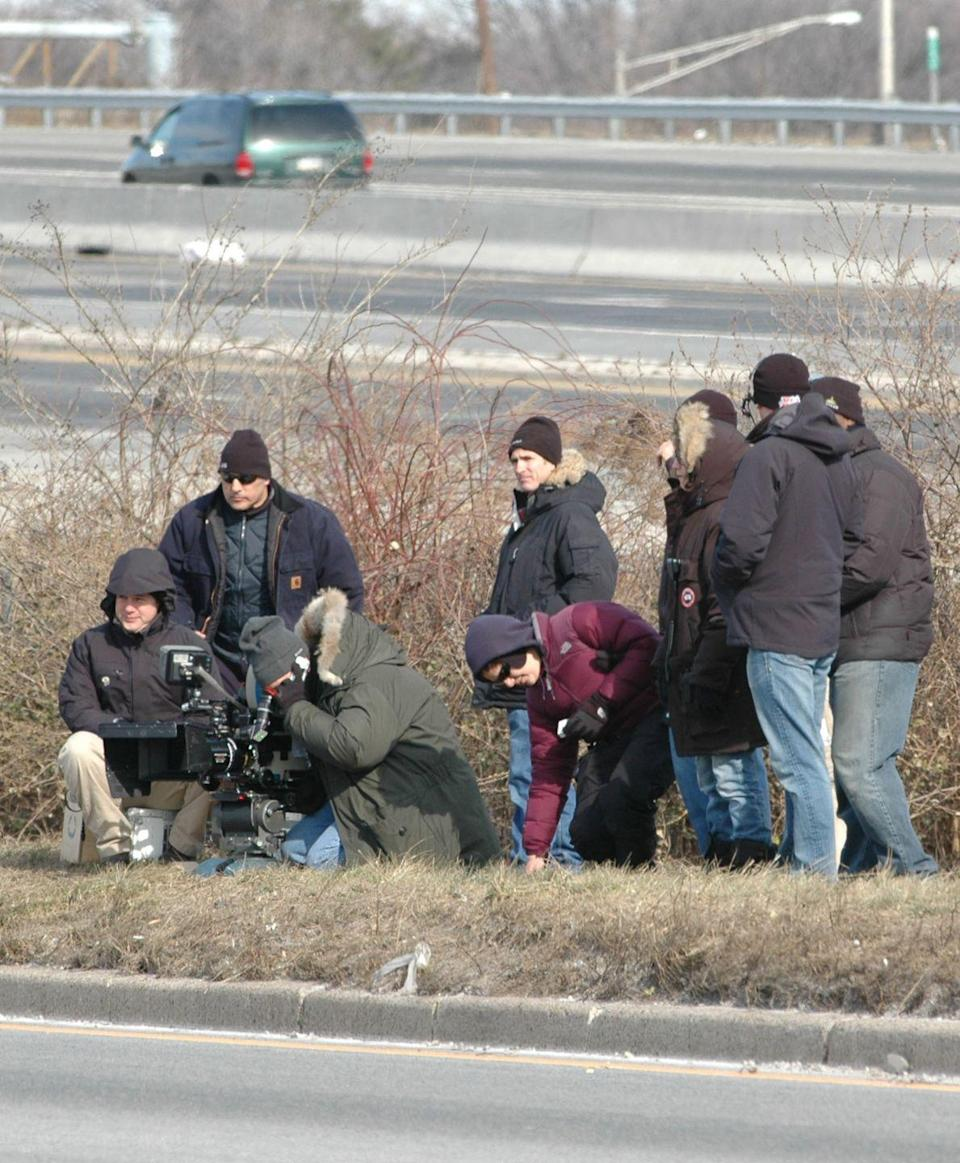 <p>On the other side of the highway, a camera crew crouched in the grass to get the perfect shot of Lynch's stunt.</p>