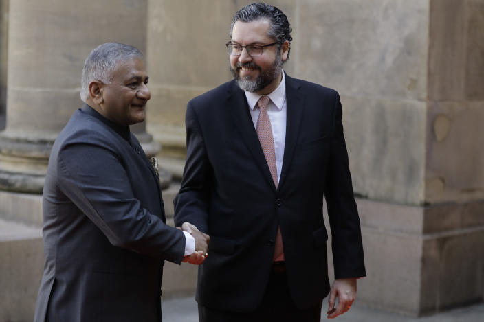 India's Minister of State for Road Transport Vijay Kumar Singh, left, and Brazil's Foreign Minister Ernesto Araujo, pose for photograpghers as he arrives to take part in a photo session of BRICS representatives, in Rio de Janeiro, Brazil, Friday, July 26, 2019. BRICS is a grouping of major emerging economies encompassing Brazil, Russia, India, China and South Africa. The delegations from the BRICS nations began meeting Friday to pave the way for a summit in November. (AP Photo/Leo Correa)
