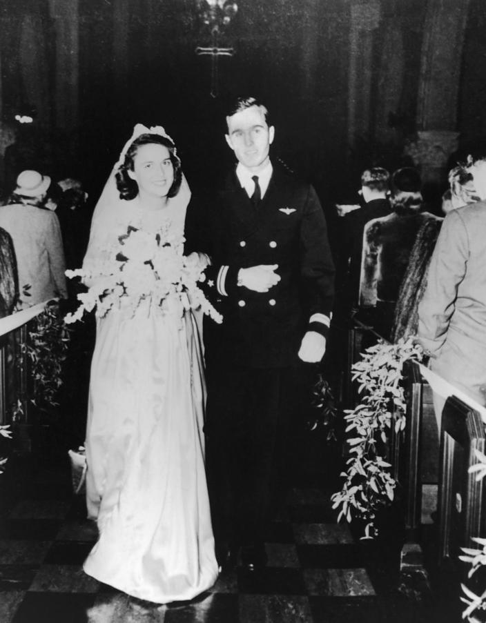 <p>Navy Lt. George Bush and Barbara Pierce are married at the First Presbyterian Church in Rye, N.Y., on Jan. 6, 1945. (Photo: Corbis) </p>