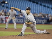 New York Yankees starting pitcher Masahiro Tanaka throws to a Toronto Blue Jays batter during the fifth inning of a baseball game in Toronto on Tuesday, June 4, 2019. (Fred Thornhill/The Canadian Press via AP)