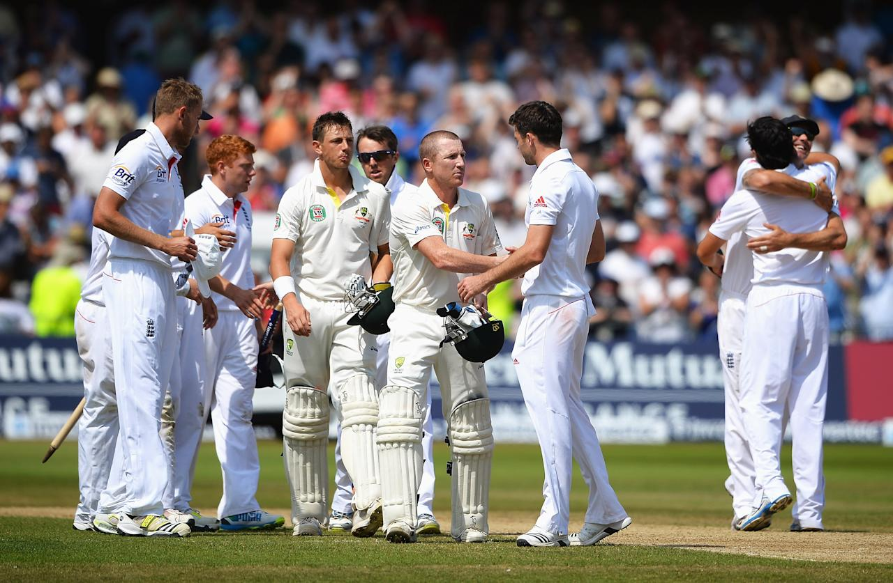 NOTTINGHAM, ENGLAND - JULY 14: Brad Haddin of Australia shakes hands with James Anderson of England as England players celebrate after day five of the 1st Investec Ashes Test match between England and Australia at Trent Bridge Cricket Ground on July 14, 2013 in Nottingham, England. (Photo by Laurence Griffiths/Getty Images)