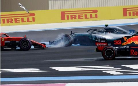 Valtteri Bottas spins after being hit by Sebastian Vettel - Credit: ap