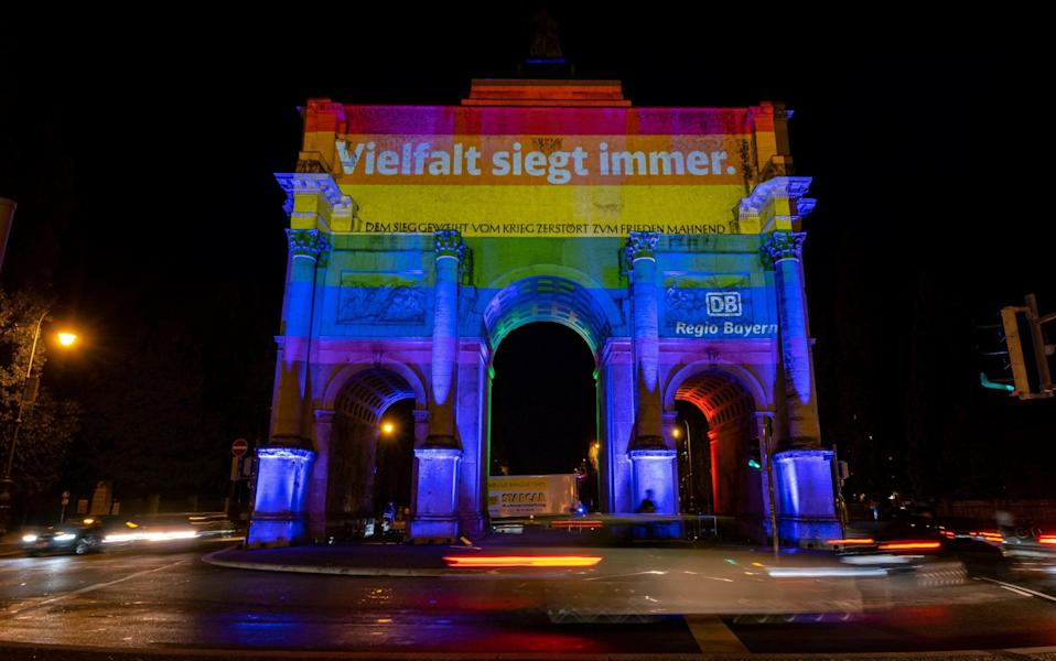 The SIEGESTOR at Ludwigstraße is illuminated in LGBT rainbow colors on June 23, 2021 in Munich - GETTY IMAGES