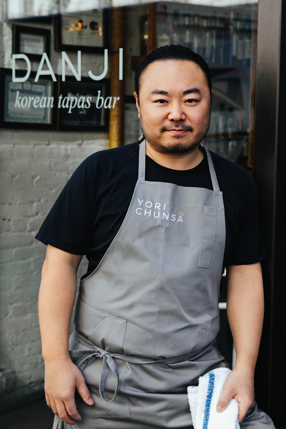 "<h1 class=""title"">Hooni Kim</h1><div class=""caption"">Kim in front of his first restaurant, Danji.</div><cite class=""credit"">Photo by Kristin Teig</cite>"