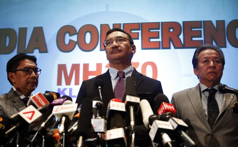Malaysia's acting Transport Minister Hishammuddin Hussein takes questions during a news conference about the missing Malaysia Airlines flight MH370, at Kuala Lumpur International Airport